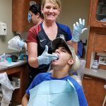 Dr. Luders taking an impression of Peyton Hurth's teeth